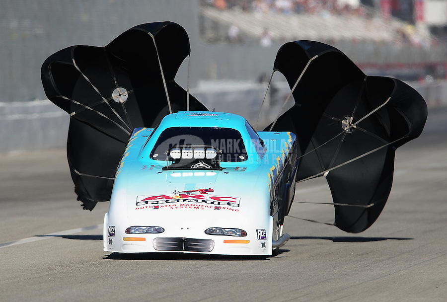 Nov 12, 2010; Pomona, CA, USA; NHRA top alcohol funny car driver Steve Burck during qualifying for the Auto Club Finals at Auto Club Raceway at Pomona. Mandatory Credit: Mark J. Rebilas-