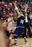Ohio State Buckeyes guard Cait Craft (13) gets fouled by Florida Atlantic Owls guard Kimberly Smith (10) as she drives to the basket in the second half of the college basketball game between the Ohio State Buckeyes and the Florida Atlantic Owls at Value City Arena in Columbus,  Sunday afternoon, November 10, 2013. The Ohio State Buckeyes narrowly defeated the Florida Atlantic Owls 91 - 88. (The Columbus Dispatch / Eamon Queeney)
