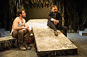 London, UK. 14.01.2013. Nameless Theatre presents THE TROJAN WOMEN, freely adapted from Seneca by Howard Colyer and directed by James Farrell, at the Brockley Jack Studio Theatre. Design by Libby Todd. Lighting design by Steve Lowe. Picture shows: Georgio Galassi (Talthybius) and Daniel Wiltshire (Ulysses). Photo credit: Jane Hobson.