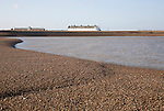 White terrace of Coastguard Cottages, beach and sea viewed from offshore, Shingle Street, Suffolk, England