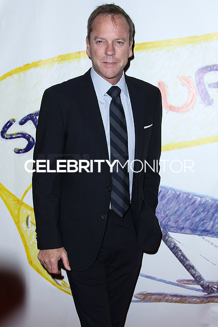 "WEST HOLLYWOOD, CA - NOVEMBER 13: Kiefer Sutherland at the ""Stand Up For Gus"" Benefit held at Bootsy Bellows on November 13, 2013 in West Hollywood, California. (Photo by Xavier Collin/Celebrity Monitor)"