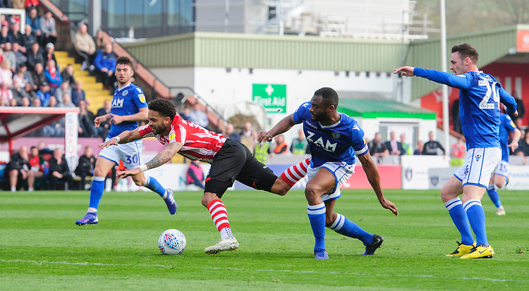 Lincoln City's Bruno Andrade is fouled by Macclesfield Town's Nathan Cameron which lead to the Imps' goal<br /> <br /> Photographer Chris Vaughan/CameraSport<br /> <br /> The EFL Sky Bet League Two - Lincoln City v Macclesfield Town - Saturday 30th March 2019 - Sincil Bank - Lincoln<br /> <br /> World Copyright © 2019 CameraSport. All rights reserved. 43 Linden Ave. Countesthorpe. Leicester. England. LE8 5PG - Tel: +44 (0) 116 277 4147 - admin@camerasport.com - www.camerasport.com