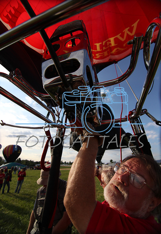 Pilot Don Boyer prepares to launch his Wells Fargo balloon at the 30th anniversary of the Great Reno Balloon Race, in Reno, Nev., on Friday, Sept. 8, 2011..Photo by Cathleen Allison