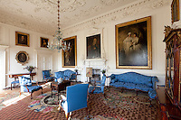 The Thomas Chippendale furniture in the drawing room has been restored to its former glory with new blue damask upholstery. The Axminster carpet dates from 1755