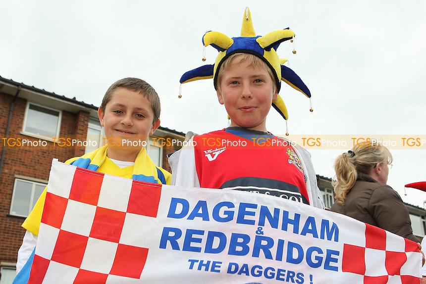 Daggers fans await the arrival of the bus - League Two Play-Off winners Dagenham & Redbridge FC attend a reception at Dagenham Civic Centre and then journey back to Victoria Road by open top bus - 31/05/10 - MANDATORY CREDIT: Gavin Ellis/TGSPHOTO - Self billing applies where appropriate - Tel: 0845 094 6026
