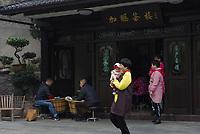 Longjing Village, Hangzhou, Zhejiang province, China  - Tea farmers sell the famed Longjing green tea, April 2018.