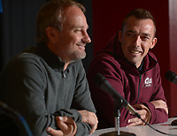 NWA Democrat-Gazette/ANDY SHUPE<br /> Little Rock soccer coach Mark Foster (right) smiles at Arkansas soccer coach Colby Hale Thursday, Nov. 8, 2018, during a press conference in Bud Walton Arena ahead of today's NCAA Women's Soccer Tournament first-round game.