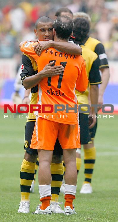 FBL  2007/2008 3.Spieltag Hinrunde<br /> Borussia Dortmund vs FC Energie Cottbus 3:0 (1:0)<br /> Delron Buckley (Dortmund #26) muss Ervin Skela ( Cottbus  #11) nach em Spiel tr&ouml;sten.<br /> Foto &copy; nph (  nordphoto  )<br /> <br /> <br /> <br />  *** Local Caption ***