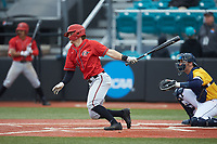 Mike Jarvis (14) of the San Diego State Aztecs follows through on his swing against the UNCG Spartans at Springs Brooks Stadium on February 16, 2020 in Conway, South Carolina. The Spartans defeated the Aztecs 11-4.  (Brian Westerholt/Four Seam Images)