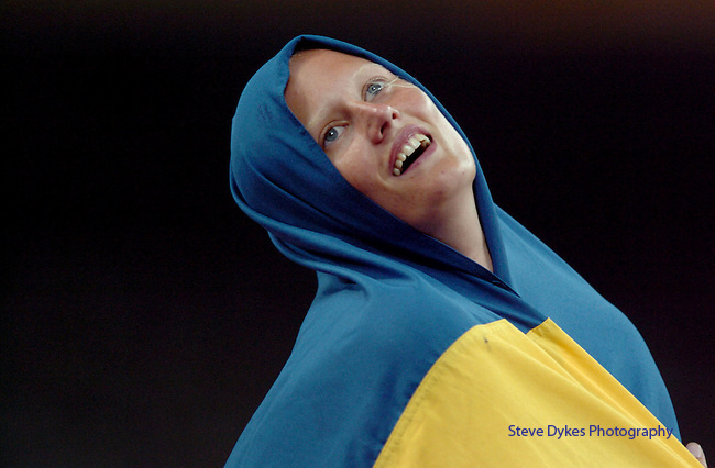 Sweedens' Carolina Kluft is all starry eyed as she wraps herself in her countries flag after winning the Heptaathalon at the 2004 Summer Olympic Games in Athens,Greece on Saturday, August 21st, 2004.          DENVER POST PHOTO BY STEVE DYKES