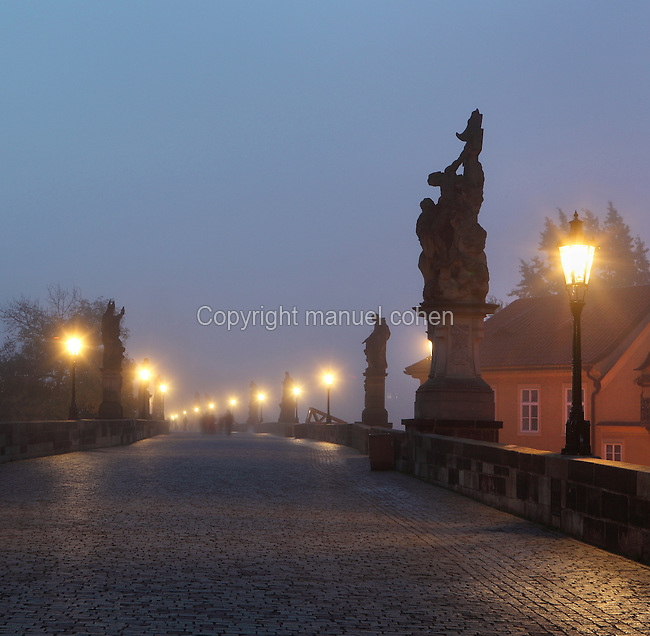 The Charles Bridge or Karluv most at dawn, built 1357 - 15th century, across the Vltava river in Prague, Czech Republic. Its construction began under King Charles IV, replacing the old Judith Bridge built 1158'??1172 after flood damage in 1342. This new bridge was originally called the Stone Bridge (Kamenny most) or the Prague Bridge (Prazsky most) but has been the Charles Bridge since 1870. The bridge is 621m long and nearly 10m wide, resting on 16 arches shielded by ice guards. It is protected by three bridge towers, two on the Lesser Quarter side and one on the Old Town side. The historic centre of Prague was declared a UNESCO World Heritage Site in 1992. Picture by Manuel Cohen