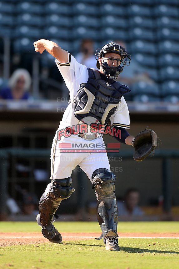 Surprise Saguaros catcher Adam Weisenburger (60), of the Milwaukee Brewers organization, during an Arizona Fall League game against the Salt River Rafters on October 14, 2013 at Surprise Stadium in Surprise, Arizona.  Salt River defeated Surprise 3-2.  (Mike Janes/Four Seam Images)
