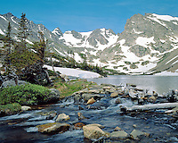 Lake Isabelle flows from its outlet below the Indian Peaks.