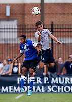 Josh Turnley (11) of Georgetown goes up for a header with Carlos McCrary (14) of Creighton during the game at Shaw Field on the campus of the Georgetown University in Washington, DC.  Georgetown tied Creighton, 0-0, in double overtime.