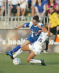 Birgit Prinz (9) and Nancy Augustyniak (25) at SAS Stadium in Cary, North Carolina on 7/4/03 during a game between the Carolina Courage and Atlanta Beat. The Courage won 3-2.