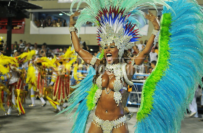 A dancer of Inocentes de Belford Roxo samba school performs at Sambadrome, Rio de Janeiro, Brazil, February 10, 2013. The Inocentes do Belford Roxo Samba school parade pays tribute to South Korea during Rio de Janeiro's 2013 carnival celebrations. (Austral Foto/Renzo Gostoli)