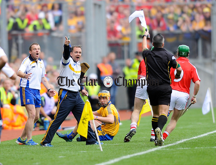 Clare manager David Fitzgerald and Saoirse Bulfin are not happy with a linesman decision during the All-Ireland senior hurling final against Cork at Croke Park. Photograph by John Kelly.