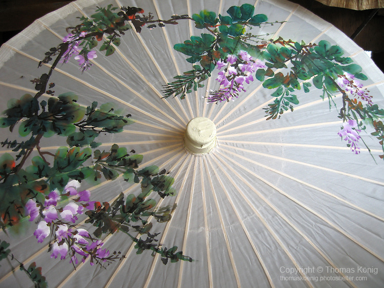 Meinong, Taiwan -- Hand-made oil paper umbrella with a traditional flower motif.