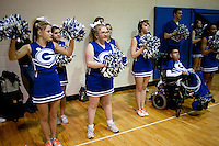 Jillian Hanley (cq, front left) Georgi McFail (cq, second from left) and other Grandview High School unified basketball team cheerleaders cheer during a game against Overland High School at Grandview High School in Aurora, Colorado, Wednesday, February 1, 2012. Unified sports teams, an outgrowth of the Special Olympics, are teams with both special needs and traditional high school students as players. The idea is that special needs kids shouldn't be separated and be allowed to participate in a competitive games as well at their schools...Photo by Matt Nager