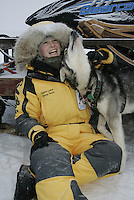 Saturday February 25, 2006 Willow, Alaska.   Ellen King relaxes with one of her dogs prior to the start  of the Junior Iditarod sled dog race.  Willow Lake.