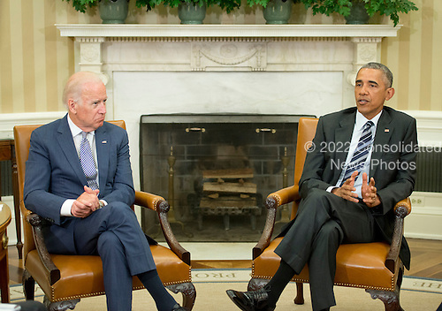 United States President Barack Obama, right, makes remarks to the media as US Vice President Joe Biden, left, listens after receiving an update on the investigation into the attack in Orlando, Florida in the Oval Office of the White House in Washington, DC on Monday, June 13, 2016. <br /> Credit: Ron Sachs / Pool via CNP
