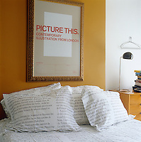 The pillow cases and duvet cover on the bed are printed with a French script