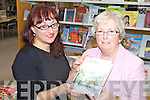 NEW BOOK: Mary Cogan (right) who has just published 'Listowel Through A Lens' presenting Listowel librarian, Martina Daly with a copy of the book at the library last Thursday.
