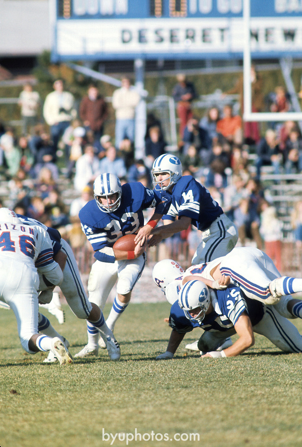 FTB 1977-Christensen<br /> <br /> BYU vs Arizona. 14 Gifford Nielsen Quarterback hand-off to 33 Todd Christensen.<br /> <br /> October 29, 1977<br /> <br /> Box: 6373<br /> <br /> Photography by: Mark Philbrick/BYU<br /> <br /> Copyright BYU PHOTO 2008<br /> All Rights Reserved<br /> 801-422-7322<br /> photo@byu.edu