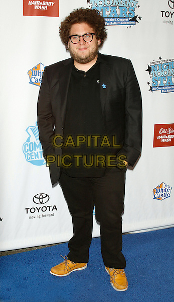 "JONAH HILL.""Night of Too Many Stars"" - a night of comedy to benefit Autism Speaks and to raise awareness of the disorder.at the Beacon Theater, New York, NY, USA..April 13th, 2008 .full length black suit hands in pockets beard facial hair glasses .CAP/LNC/TOM.©TOM/LNC/Capital Pictures"