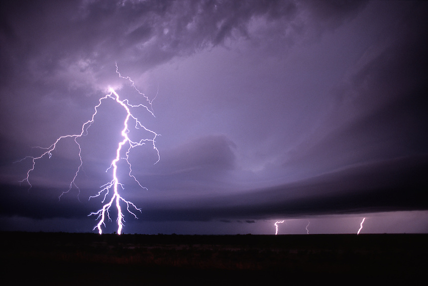 Forked cloud-to-ground lightning heralds the approach of a tornadic thunderstorm in southwest Texas.