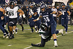 Nevada running back Toa Taua (35) is grabbed  by Hawaii's Cortez Davis (18) in the first half of an NCAA college football game in Reno, Nev., Saturday, Sept. 28, 2019. (AP Photo/Tom R. Smedes)