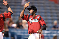 Nashville Sounds shortstop Hector Gomez (14) after hitting a home run during the second game of a double header against the Omaha Storm Chasers on May 21, 2014 at Herschel Greer Stadium in Nashville, Tennessee.  Nashville defeated Omaha 13-4.  (Mike Janes/Four Seam Images)