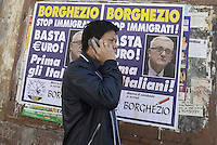 Roma, 14 Maggio 2014<br /> L'eurodeputato della Lega Nord Mario Borghezio visita il rione multietnico di Piazza Vittorio per la campagna elettorale per le Elezioni europee.<br /> Manifesti elettorali al Mercato Esquilino.<br /> The euro deputy of the Northern League Mario Borghezio visit the multi ethnic district of Piazza Vittorio to the electoral campaign for the European elections. <br /> Campaign posters at the Esquiline market