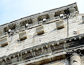 Exterior photo of the top architecture of the remaining outer wall of the Colosseum, also known as the Flavian Amphitheatre, showing some of the two hundred and forty brackets or corbels, that held a tall beam of wood that supported the awning or velarium, in Rome, Italy on Friday, May 25, 2012.  The corresponding openings or sockets that supported the beams are also clearly visible..Credit: Ron Sachs / CNP