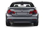 Straight rear view of a 2015 BMW 5 Series 528i 4 Door Sedan Rear View  stock images
