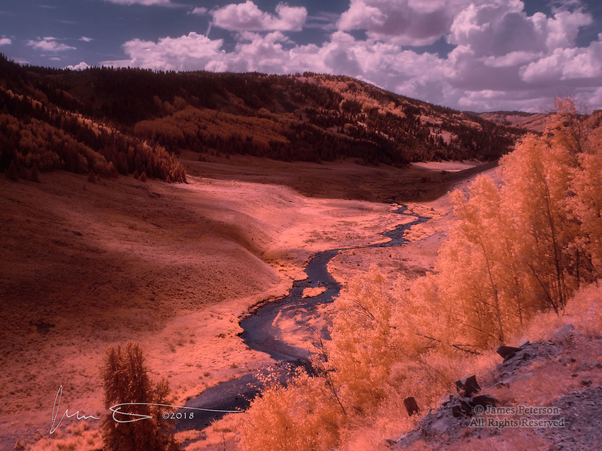 Rio de Los Pinos, near Osier, Colorado (Infrared) ©2018 James D Peterson.  Viewed from the southbound train of the Cumbres and Toltec Scenic Railroad, and photographed in infrared light, this river valley in the southern San Juan Mountains shows off its unique charm on a summer afternoon.