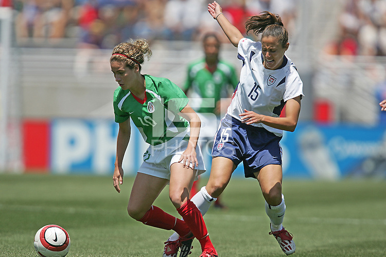 Iris Mora, left, Kate Markgraf, right, USA v Mexico, 2004.
