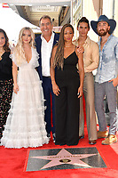 LOS ANGELES, CA. July 24, 2019: Dove Cameron, Kenny Ortega, Monique Coleman & Booboo Stewart at the Hollywood Walk of Fame Star Ceremony honoring Kenny Ortega.<br /> Pictures: Paul Smith/Featureflash