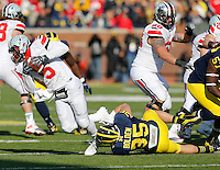 Michigan Wolverines linebacker Joe Bolden (35) sacks Ohio State Buckeyes quarterback Braxton Miller (5) in the second quarter of the college football game between the Ohio State Buckeyes and the Michigan Wolverines at Michigan Stadium in Ann Arbor, MI Saturday afternoon, November 30, 2013. The Ohio State Buckeyes defeated the Michigan Wolverines 42 - 41. (The Columbus Dispatch / Eamon Queeney)