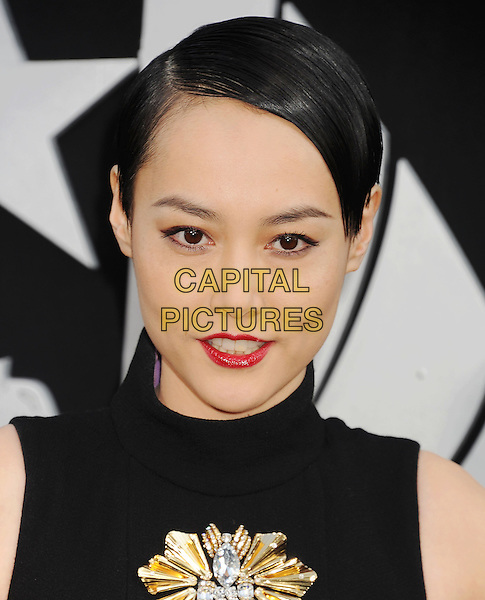 Rinko Kikuchi<br /> &quot;Pacific Rim&quot; Los Angeles Premiere held at the Dolby Theatre, Hollywood, California, USA.<br /> July 9th, 2013<br /> half length black dress sleeveless gold silver embellished jewel encrusted red lipstick <br /> CAP/ROT/TM<br /> &copy;Tony Michaels/Roth Stock/Capital Pictures