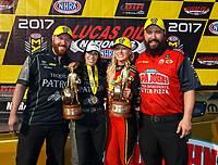 Aug 20, 2017; Brainerd, MN, USA; NHRA top fuel driver Leah Pritchett (right) and funny car driver Alexis DeJoria celebrate after becoming the first women to sweep nitro classes during the Lucas Oil Nationals at Brainerd International Raceway. Mandatory Credit: Mark J. Rebilas-USA TODAY Sports