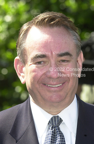 United States Secretary of Health and Human Services Tommy Thompson meets reporters at the White House following the Rose Garden event in Washington, DC where US President George W. Bush named John P. Walters as Drug Czar on May 10, 2001.<br /> Credit: Ron Sachs / CNP
