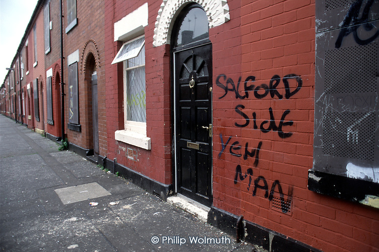 Half the houses in this unpopular district of Salford are boarded up and empty.
