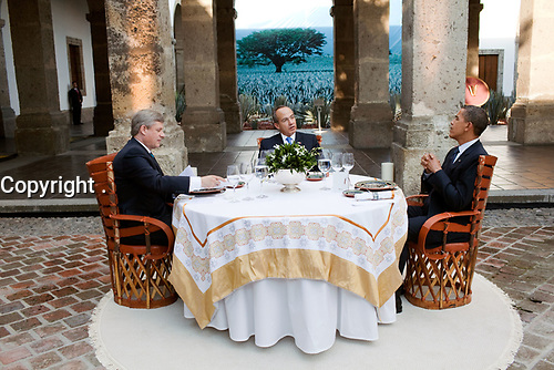 President Barack Obama, Canada's Prime Minister Stephen Harper, left, and and Mexico's President Felipe Calderon, center, sit down for a working dinner at theNorth American Leaders' Summit in Guadalajara, Mexico, August 10, 2009.  (Official White House Photo by Pete Souza)<br /> <br /> This official White House photograph is being made available only for publication by news organizations and/or for personal use printing by the subject(s) of the photograph. The photograph may not be manipulated in any way and may not be used in commercial or political materials, advertisements, emails, products, promotions that in any way suggests approval or endorsement of the President, the First Family, or the White House.