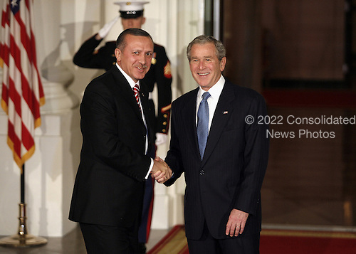 Washington, DC - November 14, 2008 -- United States President George W. Bush greets Recep Tayyip Erdogan, Prime Minister of Turkey to the White House for a working dinner at the start of the G20 Summit on Financial Markets and the World Economy..Credit: Gary Fabiano - Pool via CNP