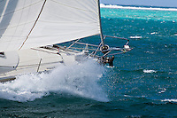 Yacht racing in the first leg of the Tahiti Pearl Regatta, from Raiatea to Bora Bora