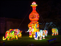 BNPS.co.uk (01202 558833)<br /> Pic: PhilYeomans/BNPS<br /> <br /> An army of Chinese artisans have created a stunning display of Oriental colour and light in the grounds of Longleat House in Wiltshire.<br /> <br /> Using 500,000 LED bulbs stretching 20 km, 20,000 individual lanterns, 80,000 pieces of porcelain and over 18 km of silk, the winter wonderland brings in thousands of visitors to the attraction over the normally fallow winter period.<br /> <br /> Organisers are putting the finishing touches to Europe's largest display of giant Chinese illuminations taking place in Britain this winter.<br /> <br /> About half a million LED lights, stretching 20km, have been used to create the stunning displays at the Festival of Light at Longleat House in Wiltshire.<br /> <br /> After the success of last year's inaugural festival, which attracted more than 150,000 visitors over the Christmas period, a team of 55 highly-skilled Chinese craftsmen have made sure this year's festival will be bigger and better.