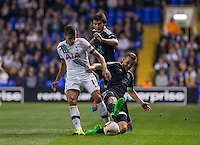 Maksim Medvedev  of Qarabag FK slides in to attempt a tackle on Erik Lamela of Tottenham Hotspur during the UEFA Europa League match between Tottenham Hotspur and Qarabag FK at White Hart Lane, London, England on 17 September 2015. Photo by Andy Rowland.