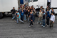 Young Moroccan fugitives try to find a truck where they could hide themselves between the wheels and enter illegaly to the port of Tanger, Morocco, 17 June 2007. Every day tens of Moroccan young men try to cross ilegally the Strait of Gibraltar. ?Harraga? (immigrants in Arabic) come to Tanger from all over Morocco. They try their good luck and hidden between the wheels of a truck they attempt to board on a ferry and get to Spain, eventually further to Europe. Considering the thorough checks at the port only few of them make it. Therefore they spend months living on a beach, in huts along the walls of the port, begging for food and waiting for the right night so as their dream about Europe came true.
