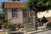 A typical Barbados chattel house in Boscobelle. This design became popular in the nineteenth century because these houses could be easily dismantled and moved when workers on sugar plantations lost their jobs and were forced to look for work elsewhere on the island.